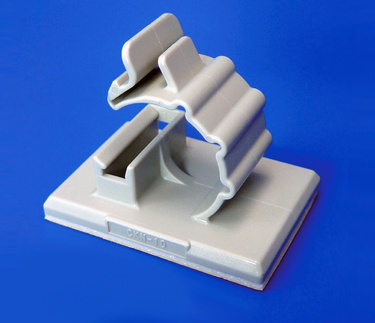 Cable clamp with a box lock, for adhesive tape fixation: CKN Series